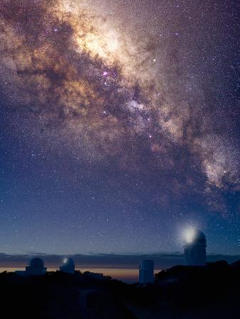 Observatories at Kitt Peak National Observatory, Arizona, USA and the Milky Way in the Night Sky