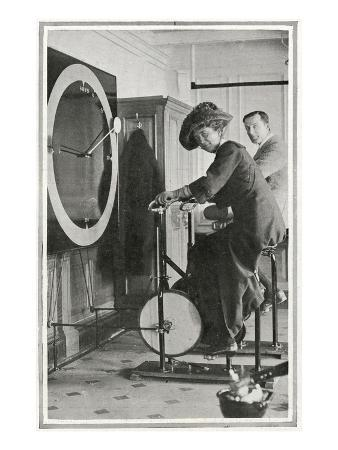 A Photograph of Passengers Using 'Cycle Racing Machines' in the Gymnasium.