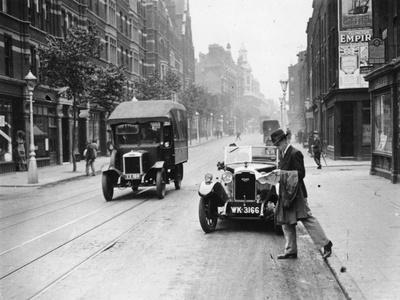 A Rover 1928 10/25 Hp Sports Car Parked in a London Street, 1931