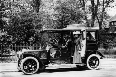Woman Stands by a 1907-8 Daimler