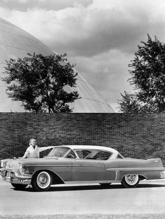 Woman with a 1957 Cadillac Coupe De Ville