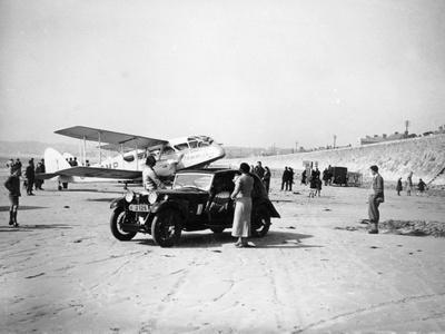 Riley Kestrel and a Dragon Aircraft on a Beach, 1934