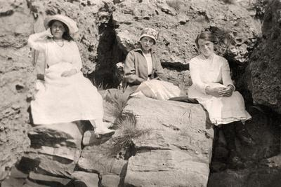 Three Women Relaxing on Rocks, Early 20th Century
