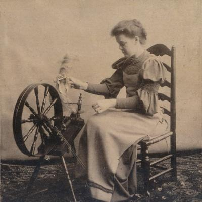 A Lady at a Spinning Wheel C1900