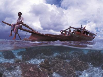 Bajau Fisherman on Lepa Boat in Shallow Water Over Coral Reef, Pulau Gaya, Borneo, Malaysia