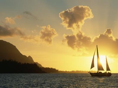 Sailing Yacht at Sunset off Coast of Hanalai Bay, Kauai, Hawaii, USA