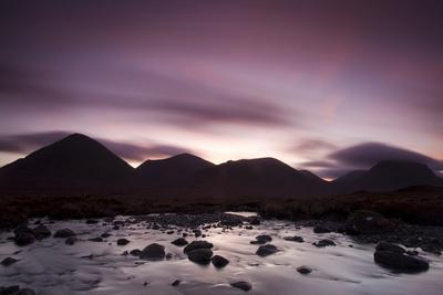 Silhouettes of the Red Cullin at Dawn, with Stream in the Foreground, Isle of Skye, Scotland, UK