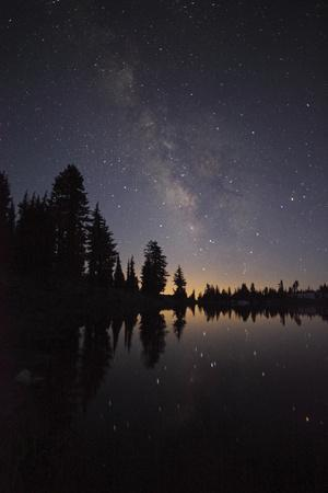 Lake with Reflection of the Milky Way and Silhouetted Trees, Lassen Volcanic Np, California, USA