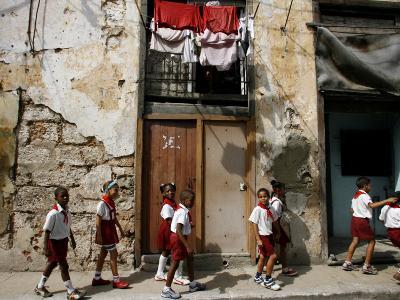 Cuban Students Walk Along a Street in Old Havana, Cuba, Monday, October 9, 2006