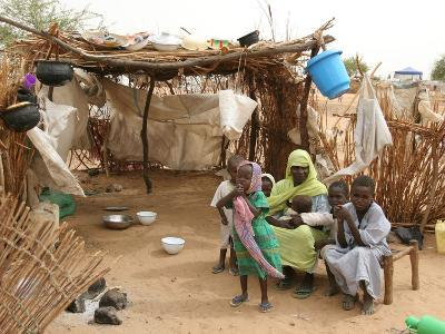 A Sudanese Family is Seen Inside Their Thatched Hut During the Visit of Unicef Goodwill Ambassador
