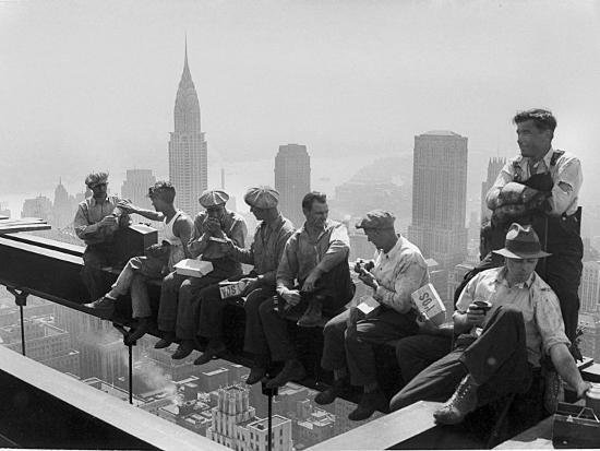 Construction Workers Take a Lunch Break on a Steel Beam Atop the ...