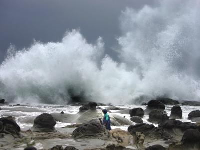 A Taiwanese Man is Dwarfed by Huge Waves Driven by Approaching Typhoon Talim
