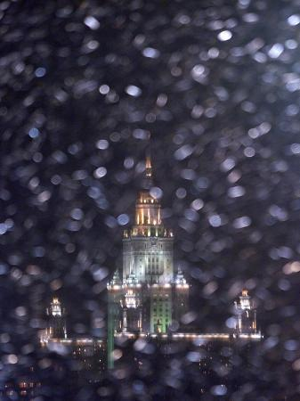Moscow State University is Illuminated During a Rare Snow Fall This Winter Season