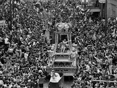 The Float Carrying Rex, King of Carnival, Squeezes Through a Massive Crowd