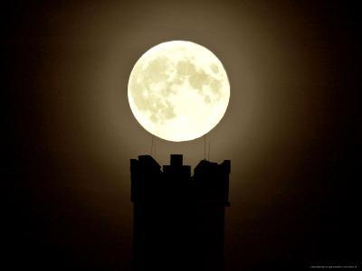 The Moon Rests on the Turret Battlements of the Castle Ruin Muehlburg