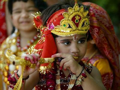 A Child Enacts the Life of Hindu God Krishna During Janamashtami Celebrations