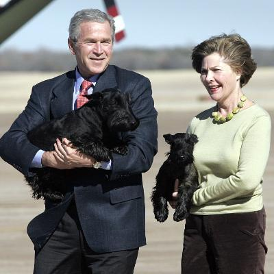 President Bush and First Lady, Laura, Carry Their Dogs