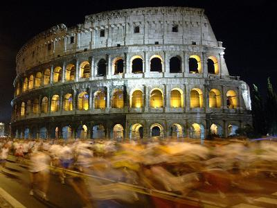 Runners Make Their Way Past the Colosseum in Rome