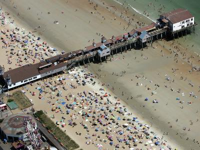 Beachgoers Crowd Around the Pier at Old Orchard Beach, Maine