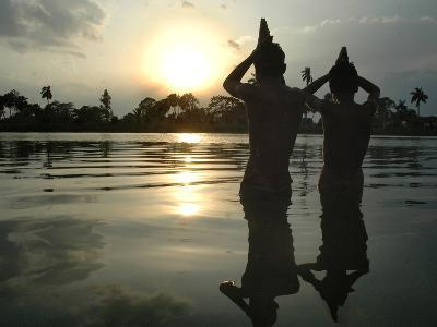 Hindu Devotees Offer Prayers to the Sun God at Sunset