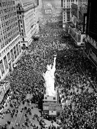 People Crowd Times Square at 42nd Street