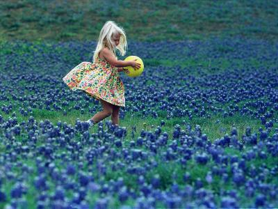 A Girl, 3, Goes for a Romp Through a Field of Bluebonnets