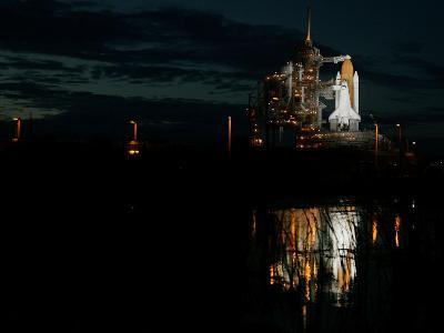 The Space Shuttle Atlantis is Reflected in a Pond on Pad 39B
