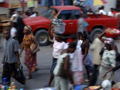 An Water Vendor Walks in the Streets of Port-Au-Prince, Haiti