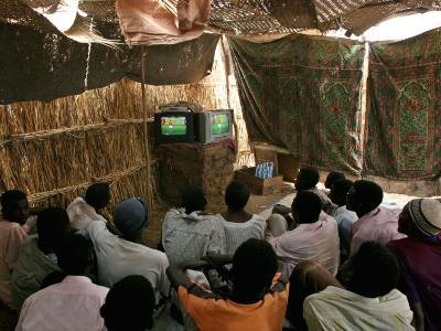 Sudanese Refugees Watch a World Cup Soccer Mach at the Zamzam Refugee Camp
