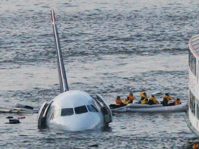 Passengers in a Raft Move from an Airbus 320 US Aircraft That Has Gone Down in the Hudson River