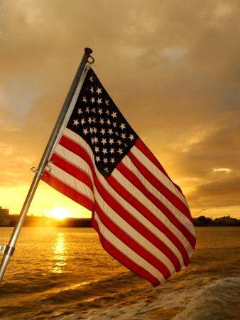 A Flag Waves Over Pearl Harbor as Dawn Breaks