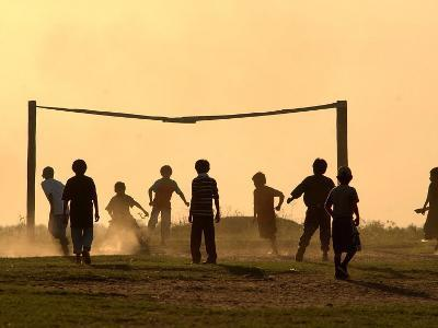 Children from the Toba Qom Ethnic Group Play Soccer During Indegenous Indian Day Celebration