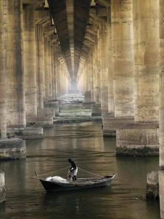Fisherman Casts His Net in the River Ganges on the Outskirts of Allahabad, India