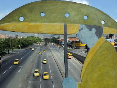 Main Avenue is Empty of Private Cars, Seen from a Bridge Decorated with a Statue of a Pedestrian