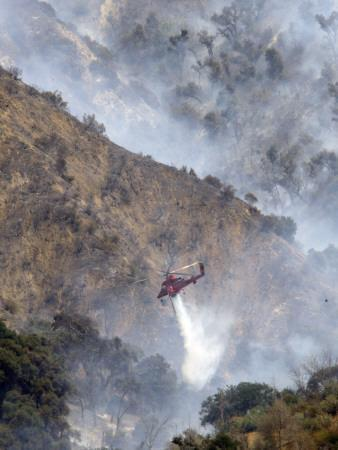 Helicopter Makes a Water Drop as Firefighters Battle a Wildfire in the San Gabriel Mountains