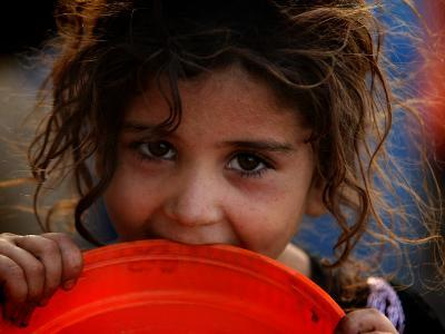 Afghan Refugee Child Who Lives in Slum Area of Lahore City in Pakistan Waits to Get Water
