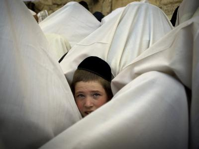 Jewish Men Participate in a Blessing During the Jewish Holiday of Passover at the Western Wall