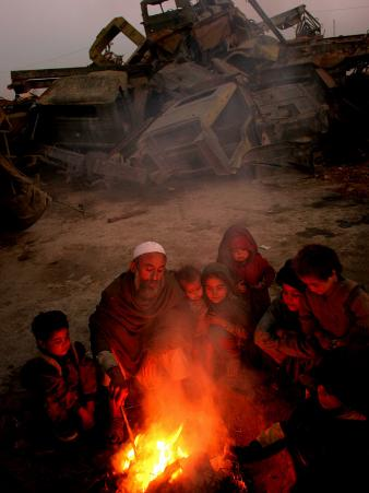 Refugees Light a Fire with Plastic and Rubbish Next to Tent in Junk Dump in Kabul, Afghanistan
