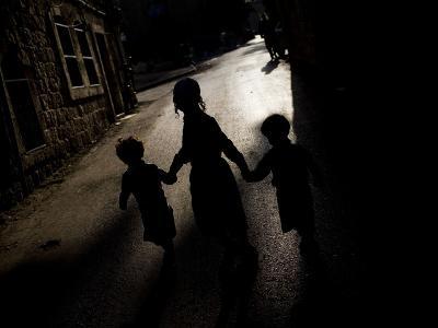 Ultra-Orthodox Jewish Children Walk in a Street in the Mea Shearim Neighborhood in Jerusalem