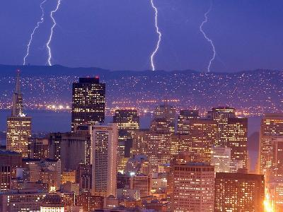 With the San Francisco Skyline in the Foreground, Lightning Strikes Over the Hills of Oakland, Ca