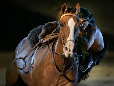 An Actor Dressed as an Indian Rides His Horse While Performing at the Opera Pampa Show
