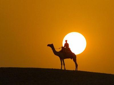 An Egyptian Policeman Looks at the Setting Sun