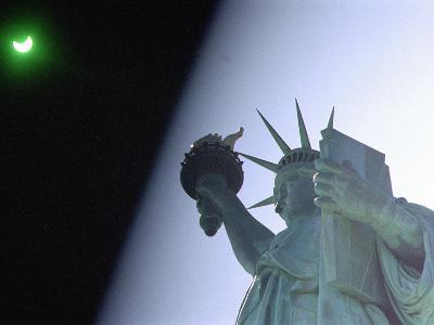 An Annular Eclipse Passes Above the Statue of Liberty