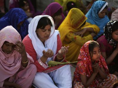 Christians Pray During a Ceremony to Celebrate Orthodox Palm Sunday, Outside a Church in Pakistan