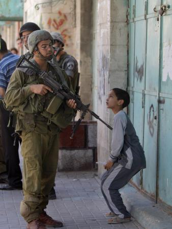 Israeli Soldier Tells a Palestinian Boy to Leave the Scene Following a Knife Attack
