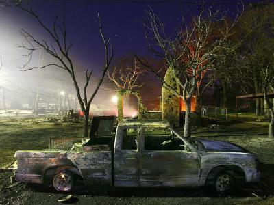 Truck Remnants in Front of a House Still Smoldering from a Grass Fire in a Small Town in Texas