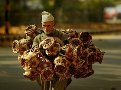 Kashmiri Carries 'Kangris' or Firepots to Sell in a Market in Srinagar, India