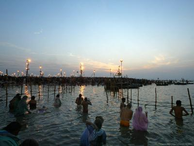 Hindu Devotees Bathe in the River Ganges on a Hindu Festival in Allahabad, India, January 14, 2007