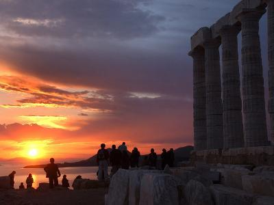 Tourists Stand Outside the Temple of Poseidon at Cape Sounion