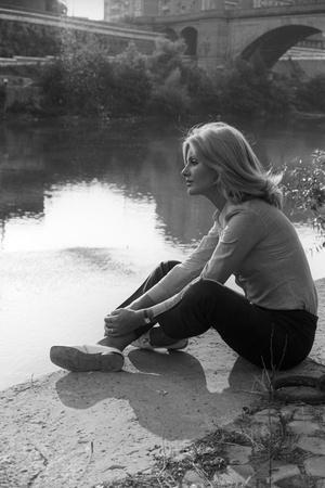 Gabriella Farinon on a River Bank